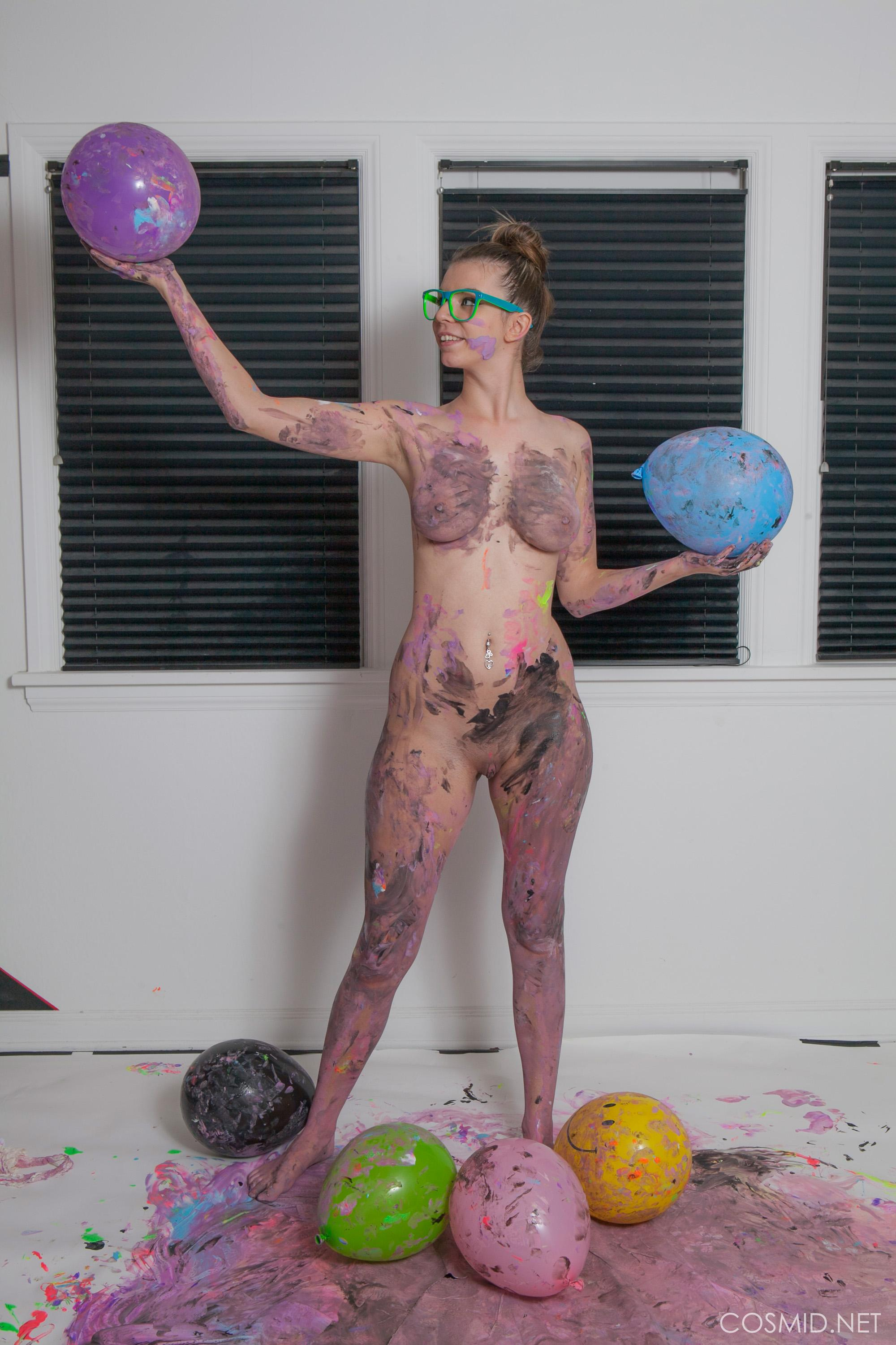a sexy nerdy chick messed up her body with paintings