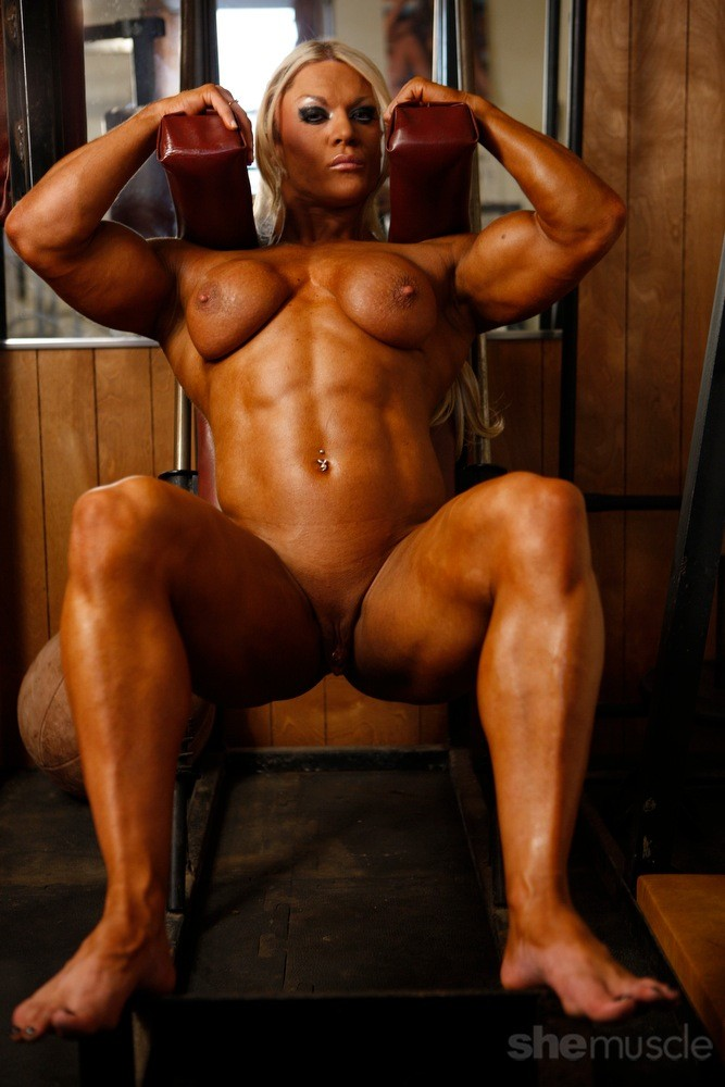 Ugly naked female bodybuilder trains her clit muscles