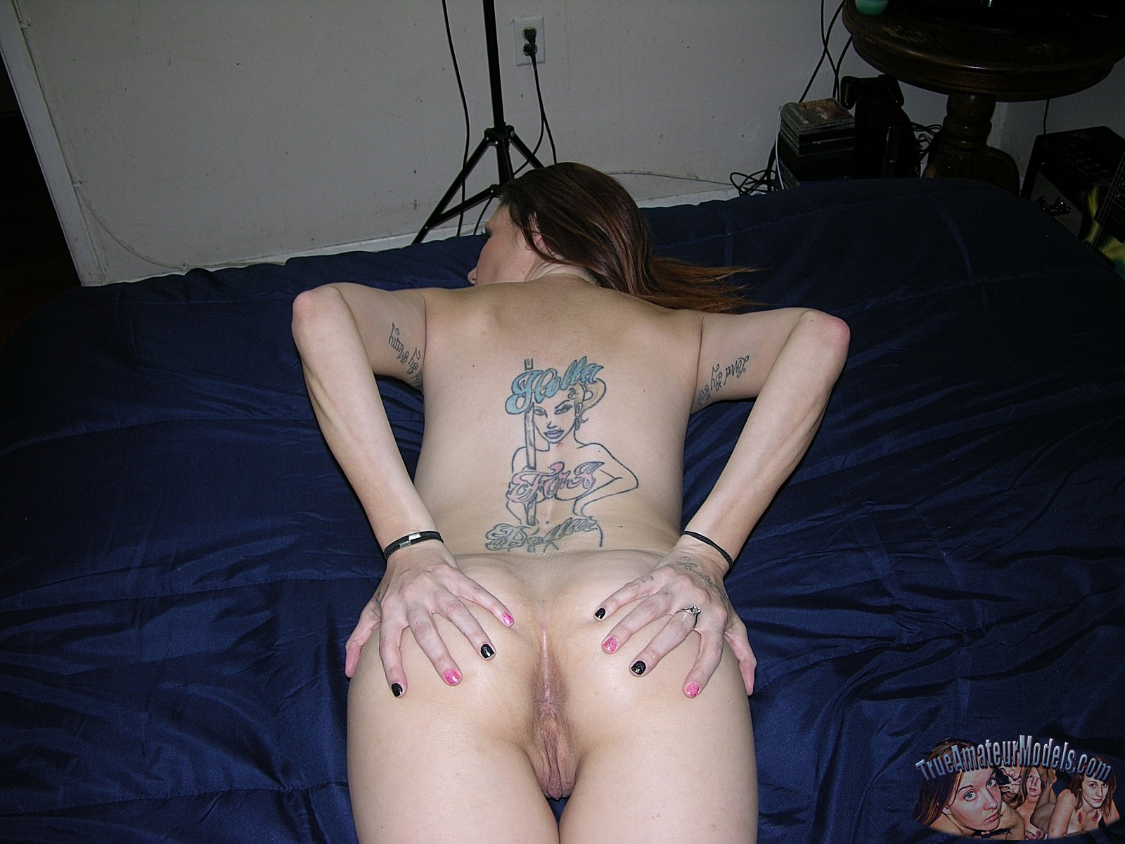 naked cutie with messed up ugly amateur tatoo flashing her beautiful pussy
